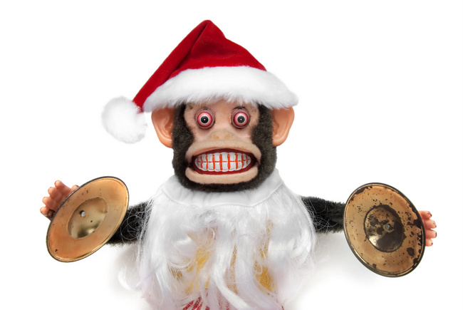 Vintage mechanical monkey toy with santa hat and beard